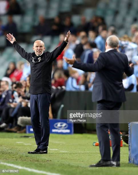 Kenny Lowe manager of the Glory has words with Graham Arnold coach of of Sydney FC after a video referee decision during the ALeague Semi Final match...
