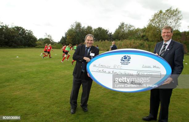 MSP Kenny MacAskill presents a cheque to Don Burns from Kirkcaldy Rugby Club during the Cashback for Communities announcement at Cluny Clays Ltd Fife