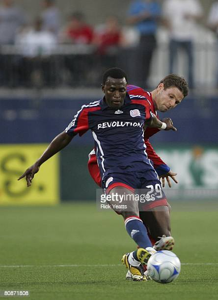 Kenny Mansally of New England takes control of the ball from Drew Moor of FC Dallas on April 24, 2008 at Pizza Hut park in Frisco, Texas. New England...