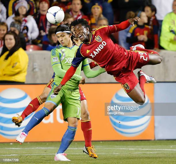 Kenny Mansally of Real Salt Lake heads the ball past Fredy Montero of the Seattle Sounders during the first half of an MLS Western Conference...