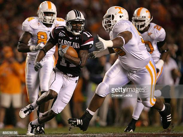 Kenny McKinley of the South Carolina Gamecocks runs away from the Tennessee Volunteers defense during their game at WilliamsBrice Stadium on November...