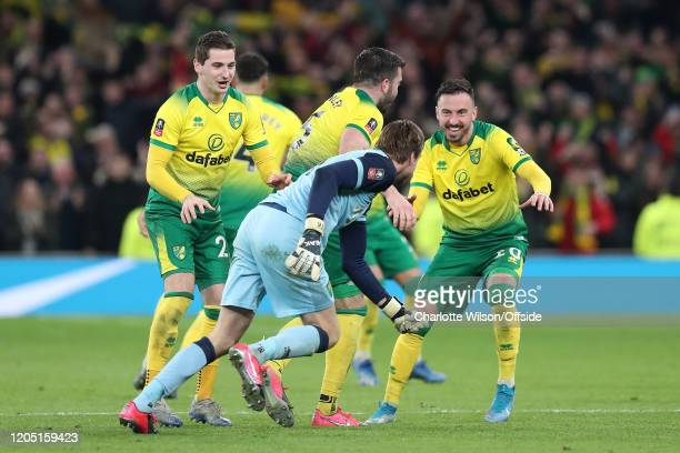 Kenny McLean and Josip Drmic of Norwich celebrate with goalkeeper Tim Krul after they go through on penalties during the FA Cup Fifth Round match...
