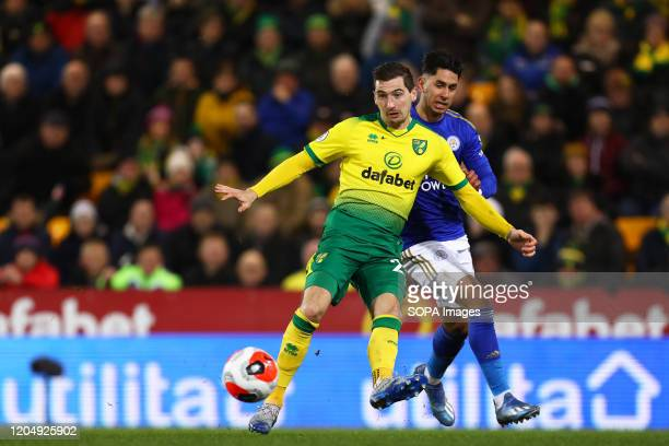 Kenny McLean of Norwich City and Ayoze Perez of Leicester City in action during the Premier League match between Norwich City and Leicester City at...