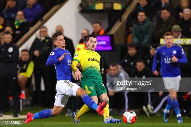 Kenny McLean of Norwich City and Dennis Praet of Leicester City in action during the Premier League match between Norwich City and Leicester City at...