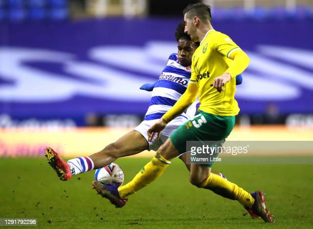 Kenny McLean of Norwich is tackled by Jayden Onen of Reading FC during the Sky Bet Championship match between Reading and Norwich City at Madejski...