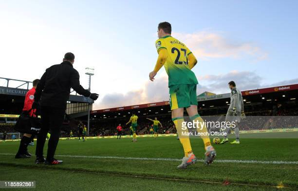 Kenny McLean of Norwich waits to return to the pitch after treatment during the Premier League match between Norwich City and Arsenal FC at Carrow...