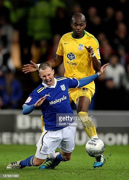 Kenny Miller of Cardiff City goes down under the challenge from Anthony Gardner of Crystal Palace during the Carling Cup Semi Final second leg match...