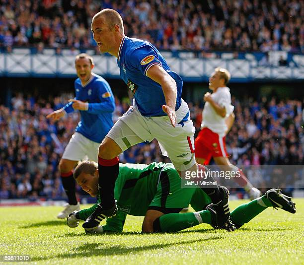 Kenny Miller of Rangers celebrates after scoring his second goal during the Scottish Premier League match between Rangers and Falkirk at Ibrox...