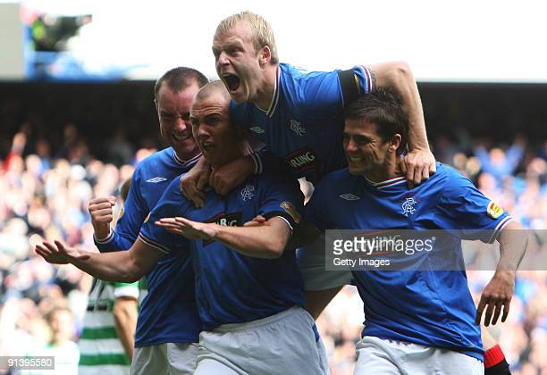 Kenny Miller of Rangers celebrates his second goal with Kris Boyd Steven Naismith and Nacho Novo during the Clysdale Bank Scottish Premier League...