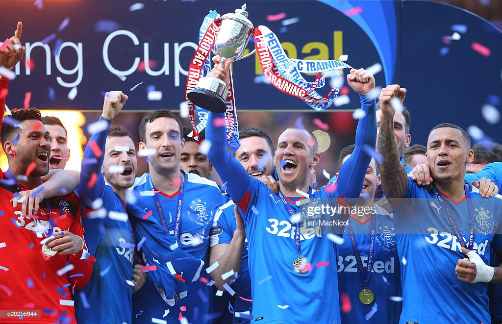 Kenny Miller of Rangers holds the trophy during the Petrofac Training Cup Final between Rangers and Peterhead at Hampden Park on April 10, 2016 in Glasgow, Scotland.