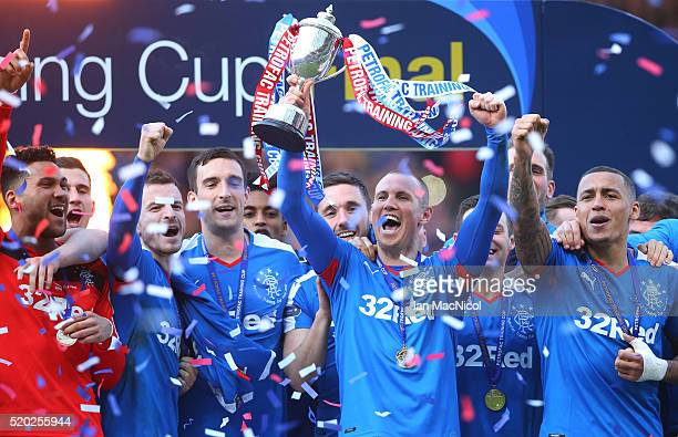 Kenny Miller of Rangers holds the trophy during the Petrofac Training Cup Final between Rangers and Peterhead at Hampden Park on April 10 2016 in...