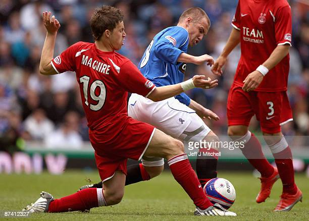 Kenny Miller of Rangers is tackled by Christopher Maguire of Aberdeen during the Scottish Premier League match between Rangers and Aberdeen at Ibrox...
