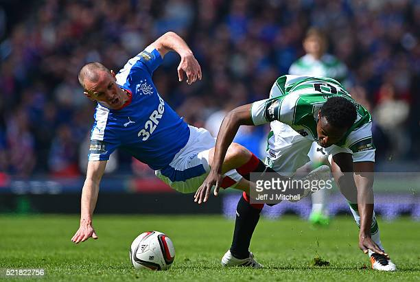 Kenny Miller of Rangers is tackled by Dedryck Boyata of Celtic during the William Hill Scottish Cup semi final between Rangers and Celtic at Hampden...