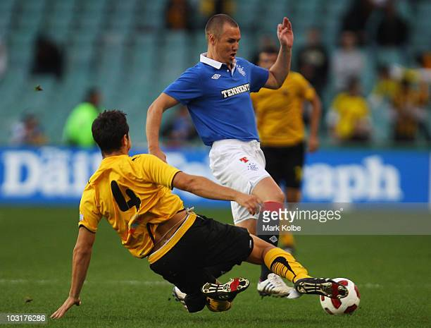 Kenny Miller of Rangers is tackled by Kostas Manolas of Athens during the preseason friendly match between AEK Athens FC and Glasgow Rangers at the...