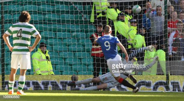 Kenny Miller of Rangers scores his teams third goal from the penalty spot during the Clydesdale Bank Premier League match between Celtic and Rangers...
