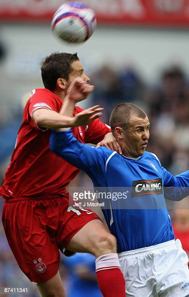 Kenny Miller of Rangers tackles Javan Vidal of Aberdeen during the Scottish Premier League match between Rangers and Aberdeen at Ibrox Stadium on May...