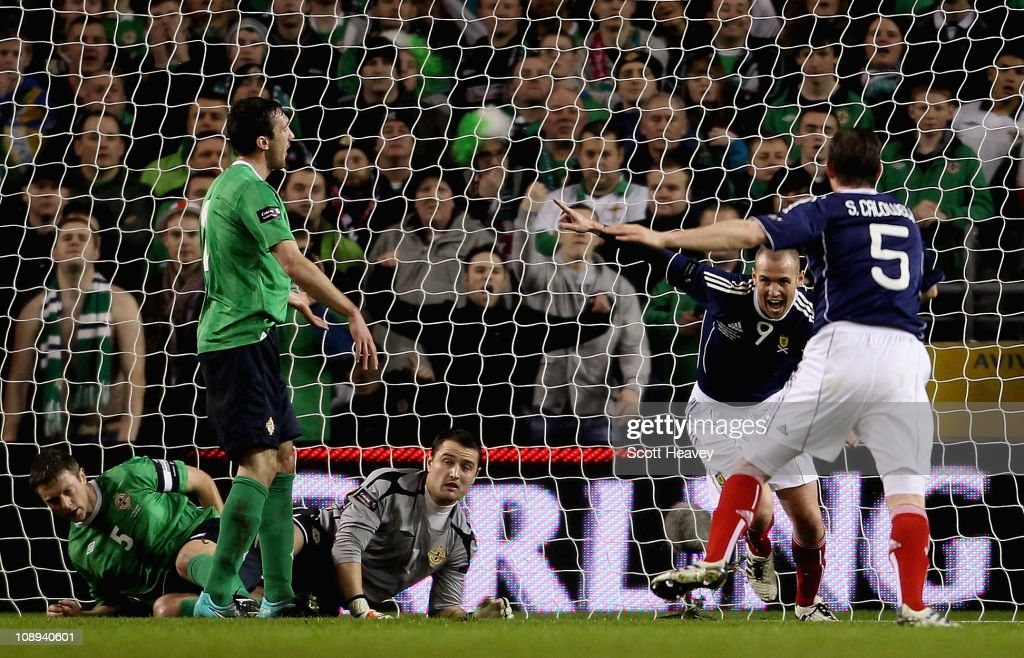 Kenny Miller of Scotland (R) celebrates after scoring their first goal during the Carling Nations Cup match between Northern Ireland and Scotland at the Aviva Stadium on February 9, 2011 in Dublin, Ireland.