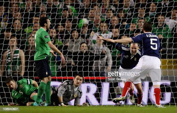 Kenny Miller of Scotland celebrates after scoring their first goal during the Carling Nations Cup match between Northern Ireland and Scotland at the...