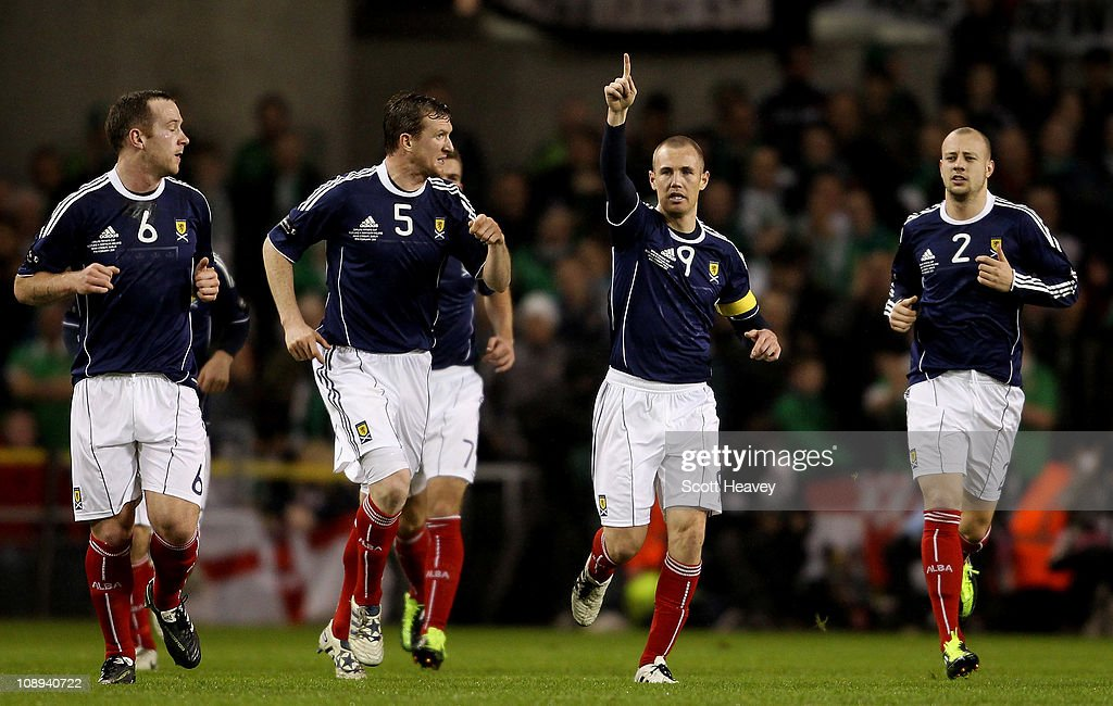 Kenny Miller of Scotland (2nd R) celebrates after scoring their first goal during the Carling Nations Cup match between Northern Ireland and Scotland at the Aviva Stadium on February 9, 2011 in Dublin, Ireland.