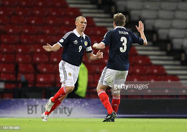 Kenny Miller of Scotland celebrates his equalizing first half goal with Paul Dixon during the 2014 World Cup qualifying football match between...