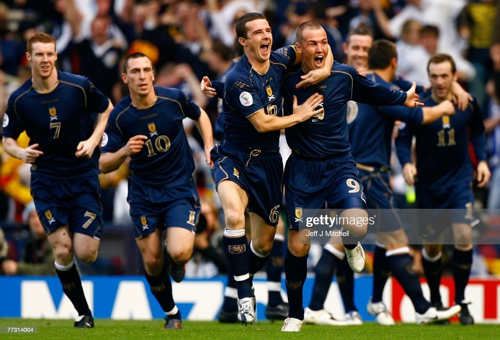 Kenny Miller of Scotland celebrates with Barry Ferguson, after scoring against Ukraine during the Euro 2008 Group B qualifying match between Scotland and Ukraine at Hampden Park on October 13, 2007 in Glasgow, Scotland