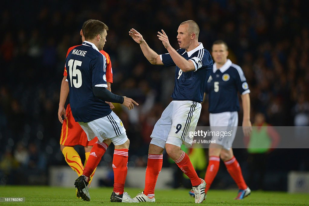 Kenny Miller of Scotland celebrates with Jamie Mackie after scoring during the FIFA World Cup Qualifier Between Scotland and Macedonia at Hampden Park on September 11, 2012 in Glasgow, Scotland.