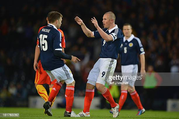 Kenny Miller of Scotland celebrates with Jamie Mackie after scoring during the FIFA World Cup Qualifier Between Scotland and Macedonia at Hampden...