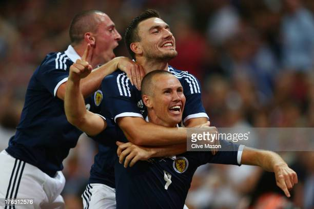 Kenny Miller of Scotland celebrates with teammates after scoring a goal during the International Friendly match between England and Scotland at...