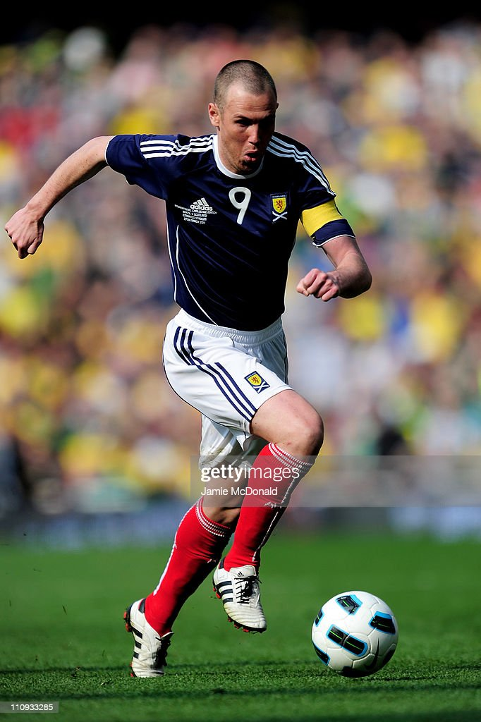 Kenny Miller of Scotland runs with the ball during the International friendly match between Brazil and Scotland at Emirates Stadium on March 27, 2011 in London, England.