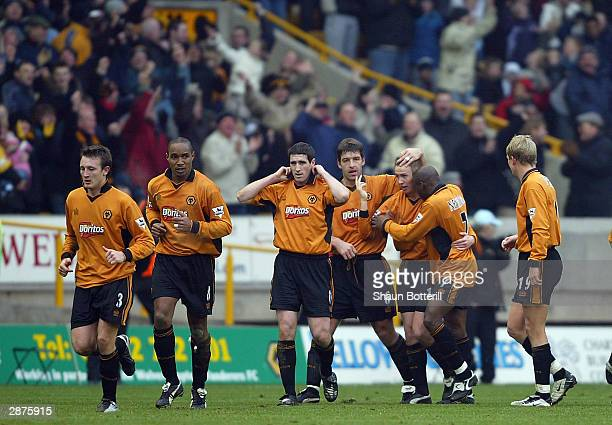 Kenny Miller of Wolverhampton Wanderers celebrates with his teammates after scoring the first goal for Wolverhampton Wanderers during the FA...