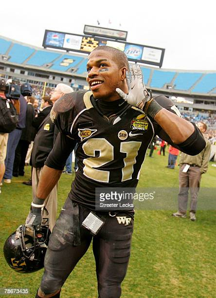 Kenny Moore of the Wake Forest Demon Deacons celebrates after defeating the Connecticut Huskies 2410 during their game at Bank of America Stadium on...