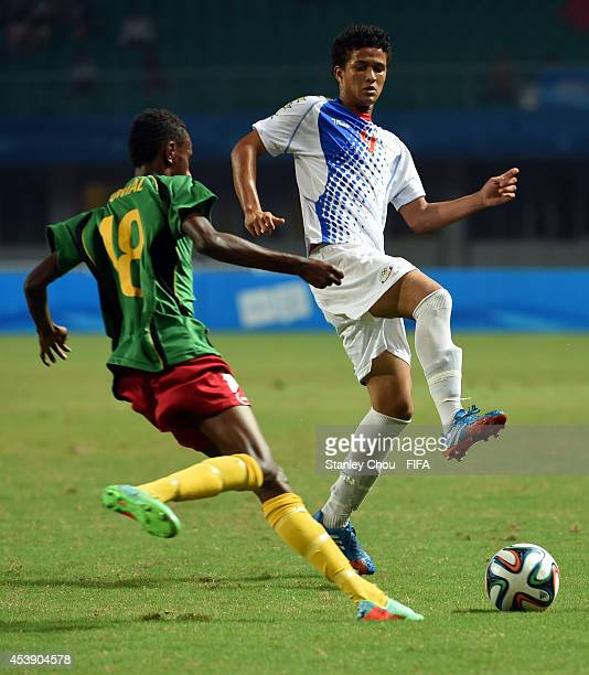 Kenny of Cape Verde Islands competes for the ball with Vira Womal of Vanuatu defenders during the 2014 FIFA Boys Summer Youth Olympic Football...