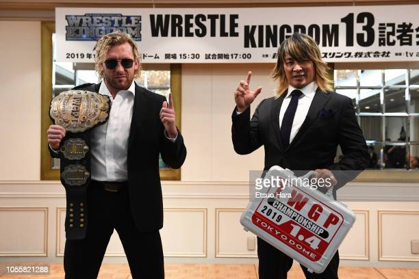 Kenny Omega and Hiroshi Tanahashi pose for photographs during a press conference of the Wrestle Kingdom 13 at Meiji Kinenkan on October 9 2018 in...