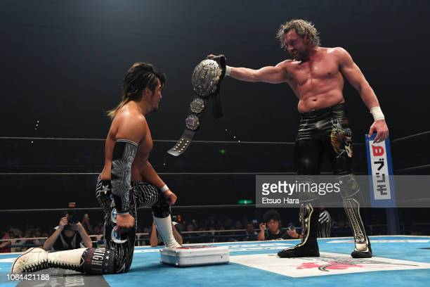 Kenny Omega shows the IWGP belt to Hiroshi Tanahashi after the tag match during the Power Struggle Super Jr Tag League 2018 at Edion Arena Osaka on...