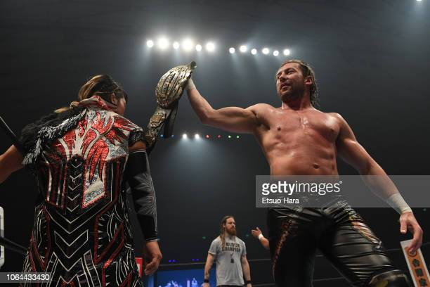 Kenny Omega shows the IWGP belt to Hiroshi Tanahashi prior to the tag match during the Power Struggle Super Jr Tag League 2018 at Edion Arena Osaka...