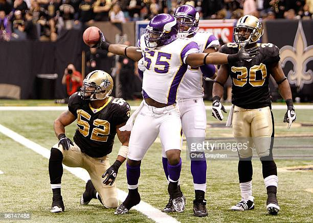 Kenny Onatolu of the Minnesota Vikings celebrates after he recovered a fumble on a muffed punt by Reggie Bush of the New Orleans Saints during the...