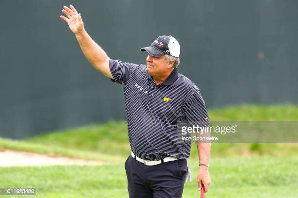 Kenny Perry celebrates after putting for birdie and the win on the 18th green during the final round of the 3M Championship on August 8 2018 at TPC...