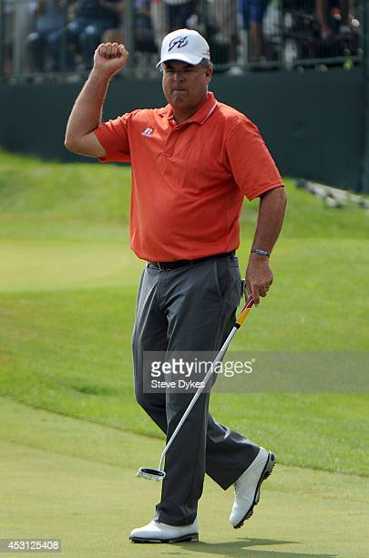 Kenny Perry celebrates after sinking a birdie putt on the 18th hole to win the 3M Championship at TPC Twin Cities on August 3 2014 in Blaine Minnesota