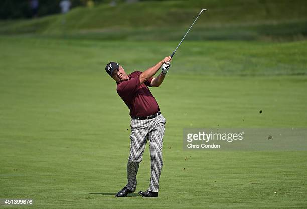 Kenny Perry hits his second shot on the 15th hole during the third round of the Constellation SENIOR PLAYERS Championship at Fox Chapel Golf Club on...