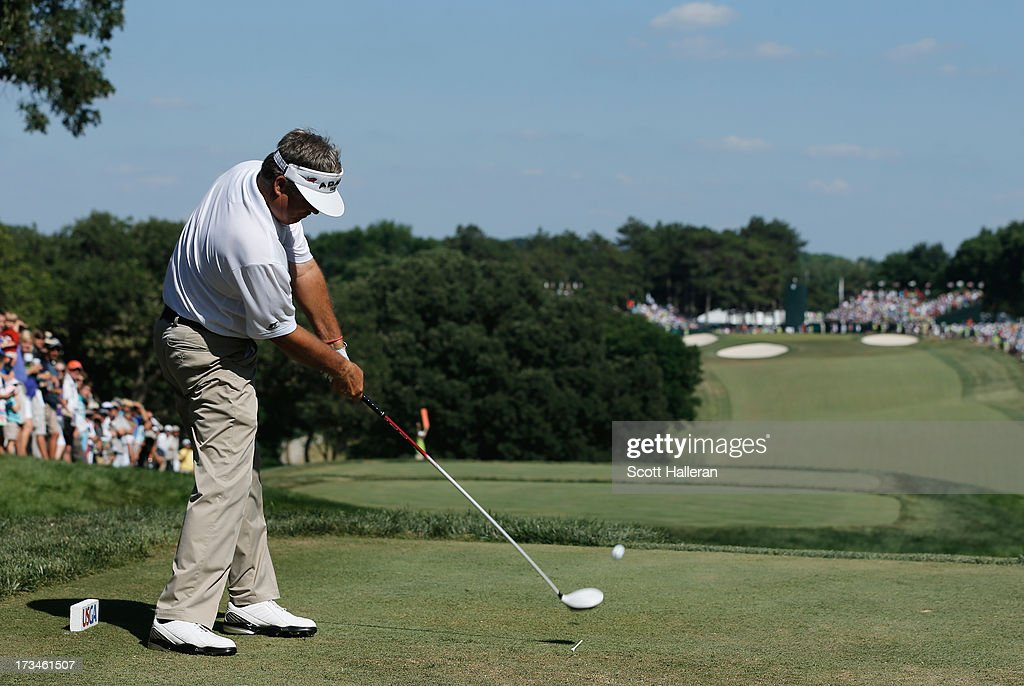Kenny Perry hits his tee shot on the 18th hole during the final round of the 2013 U.S. Senior Open Championship at Omaha Country Club on July 14, 2013 in Omaha, Nebraska.