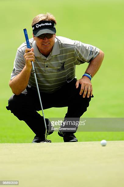 Kenny Perry lines up a putt on the seventh green during the first round of THE PLAYERS Championship held at THE PLAYERS Stadium course at TPC...