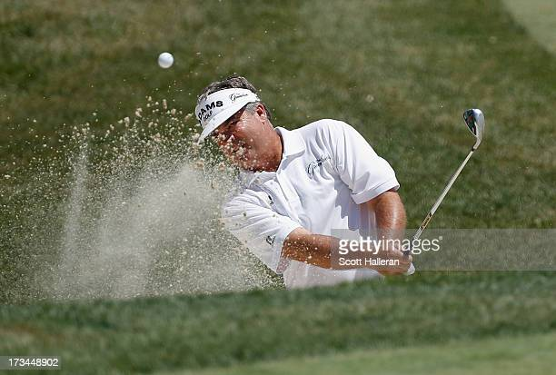 Kenny Perry plays a bunker shot on the sixth hole during the final round of the 2013 US Senior Open Championship at Omaha Country Club on July 14...