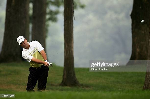 Kenny Perry plays from the trees on the 12th hole during the second round of the 2006 PGA Championship at Medinah Country Club on August 18 2006 in...
