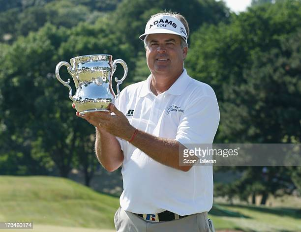 Kenny Perry poses with the trophy after his fivestroke victory at the 2013 US Senior Open Championship at Omaha Country Club on July 14 2013 in Omaha...