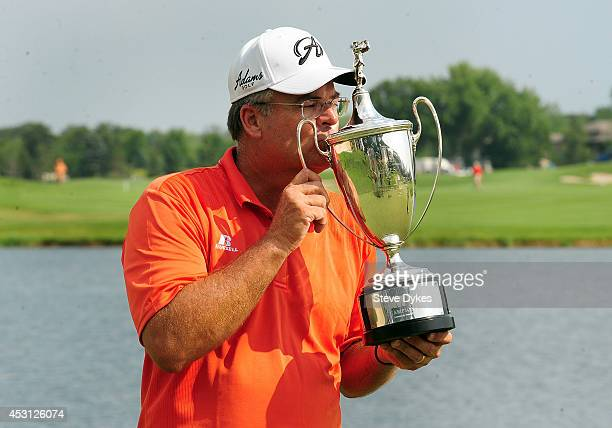 Kenny Perry poses with the trophy after winning the 3M Championship at TPC Twin Cities on August 3 2014 in Blaine Minnesota