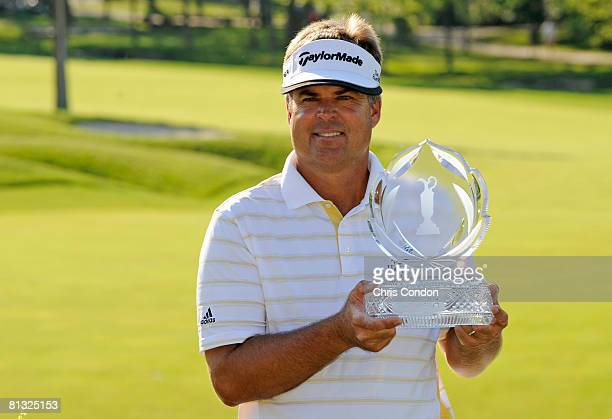 Kenny Perry poses with the trophy after winning the Memorial Tournament Presented by Morgan Stanley at Muirfield Village Golf Club held on June 1,...