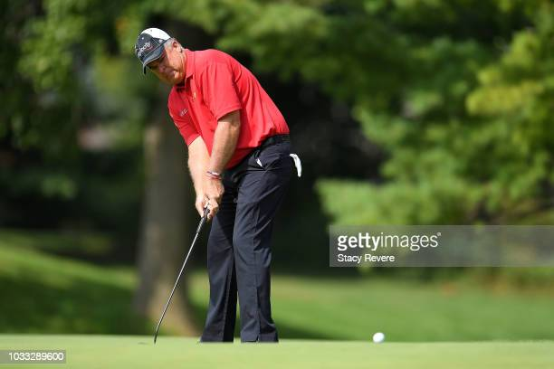 Kenny Perry putts on the first green during the first round of the Ally Challenge presented by McLaren at Warwick Hills Golf Country Club on...