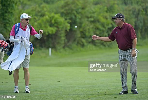Kenny Perry tosses his ball to his caddie on the 14 hole during the third round of the Constellation SENIOR PLAYERS Championship at Fox Chapel Golf...