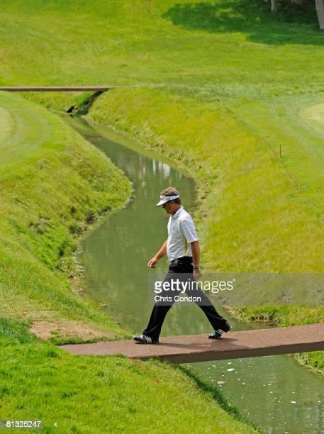 Kenny Perry walks across a bridge on during the final round of the Memorial Tournament Presented by Morgan Stanley at Muirfield Village Golf Club...