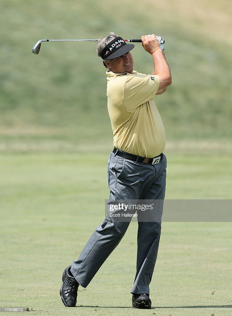 Kenny Perry watches his approach shot on the 18th hole during the third round of the 2013 U.S. Senior Open Championship at Omaha Country Club on July 13, 2013 in Omaha, Nebraska.
